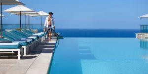 Jumeirah-Port-Soller-Infinity-Pool-Bar-Swimming-Swim-Horizon-Model-Lifestyle-front-Blue-Water-Sky-Architecture