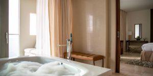 Jumeirah-Port-Soller-Observatory-Signature-Suite-Bathroom-Sea-View-Bathtub-Bubbles-2