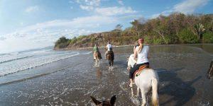 horses-crossing-river-costa-rica